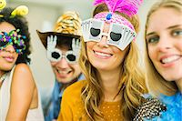 funny pose - Friends wearing decorative glasses at party Stock Photo - Premium Royalty-Freenull, Code: 6113-07148077
