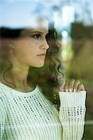 Close-up portrait of teenage girl looking out window, Germany Stock Photo - Premium Royalty-Free, Artist: Uwe Umstätter, Code: 600-07148144