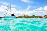 people and vacation - Close-up of ocean and sailboat at Rondinara Beach, (between Bonifacio and Porto-Vecchio) Corsica, France Stock Photo - Premium Rights-Managednull, Code: 700-07148230