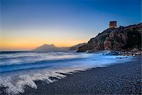 rugged landscape - Scenic view of beach, surf and Genoese Watchtower at sunset, Gulf of Porto, Corsica, France Stock Photo - Premium Rights-Managednull, Code: 700-07148240