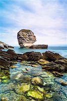scenic view - View of the rocky shoreline, cliffs and Grain de Sable Rock, Bonifacio, Corsica, France Stock Photo - Premium Rights-Managednull, Code: 700-07148273