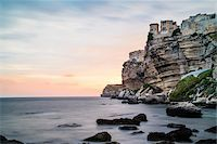 rugged landscape - Scenic view of the rocky coastline, Citadel and cliffs at sunset, Bonifacio, Corsica, France Stock Photo - Premium Rights-Managednull, Code: 700-07148277