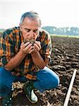 Farmer working in field, holding and smelling soil in hands, Germany Stock Photo - Premium Royalty-Free, Artist: Uwe Umstätter, Code: 600-07148334