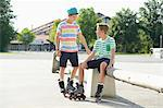 Two boys with in-line skates on a sports place Stock Photo - Premium Rights-Managed, Artist: F1Online, Code: 853-07148595