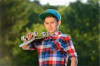preteen touch - Boy with skateboard, portrait Stock Photo - Premium Rights-Managednull, Code: 853-07148609