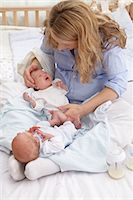 Mother and two week old fraternal twins. Stock Photo - Premium Royalty-Freenull, Code: 679-07151295