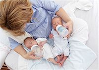 Mother feeding two week old fraternal twins. Stock Photo - Premium Royalty-Freenull, Code: 679-07151299
