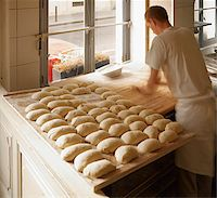Male baker shaping baguette bread dough by hand in bakery, Le Boulanger des Invalides, Paris, France Stock Photo - Premium Rights-Managednull, Code: 700-07156240