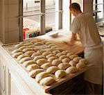 Male baker shaping baguette bread dough by hand in bakery, Le Boulanger des Invalides, Paris, France Stock Photo - Premium Rights-Managed, Artist: Michael Mahovlich, Code: 700-07156240