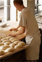 Male baker shaping baguette bread dough by hand in bakery, Le Boulanger des Invalides, Paris, France Stock Photo - Premium Rights-Managednull, Code: 700-07156241