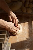 Close-up of male baker's hands kneading bread dough on floured board, Le Boulanger des Invalides, Paris, France Stock Photo - Premium Rights-Managednull, Code: 700-07156243