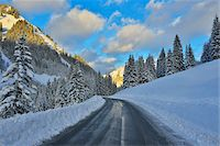 scenic view - Road in Winter with Snow Covered Mountains, Berwang, Alps, Tyrol, Austria Stock Photo - Premium Royalty-Freenull, Code: 600-07156474