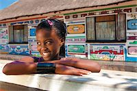 Ndebele houses and young girl Stock Photo - Premium Rights-Managednull, Code: 873-07157039