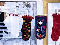 Mittens hanging on clothes line Stock Photo - Premium Royalty-Freenull, Code: 6102-07158083