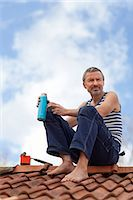 Mature man having coffee break on top of roof Stock Photo - Premium Royalty-Freenull, Code: 6102-07158141