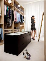 Woman trying clothes in walk-in wardrobe Stock Photo - Premium Royalty-Freenull, Code: 6102-07158208