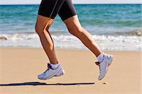 forward - Young woman running on beach, low section, Algarve, Portugal Stock Photo - Premium Royalty-Freenull, Code: 6102-07158246