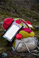 Hiking backpack with sleeping bag and map in forest Stock Photo - Premium Royalty-Freenull, Code: 698-07158623