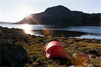 Tent at lakeshore against mountains Stock Photo - Premium Royalty-Freenull, Code: 698-07158629