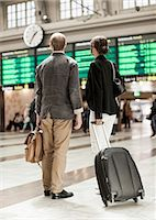 Business people with luggage standing on railway station Stock Photo - Premium Royalty-Freenull, Code: 698-07158654