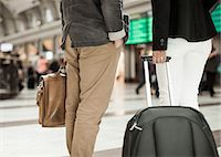Midsection of business people with luggage standing on railway station Stock Photo - Premium Royalty-Freenull, Code: 698-07158655