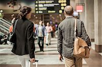Business people with luggage walking on railway station Stock Photo - Premium Royalty-Freenull, Code: 698-07158659