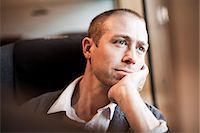 Thoughtful mature businessman sitting in train Stock Photo - Premium Royalty-Freenull, Code: 698-07158662