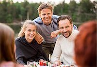 Happy friends enjoying meal outdoors Stock Photo - Premium Royalty-Freenull, Code: 698-07158703
