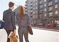 Rear view of business people standing on street Stock Photo - Premium Royalty-Freenull, Code: 698-07158785