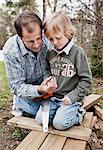 Two generation males with saw and wooden planks in yard Stock Photo - Premium Royalty-Free, Artist: Beth Dixson, Code: 698-07158799