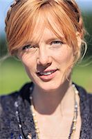 stockholm - Portrait of redhead woman in park Stock Photo - Premium Royalty-Freenull, Code: 698-07158869