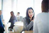 Business people talking in office Stock Photo - Premium Royalty-Freenull, Code: 6113-07159120