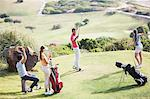 Friends teeing off on golf course Stock Photo - Premium Royalty-Free, Artist: Blend Images, Code: 6113-07159241