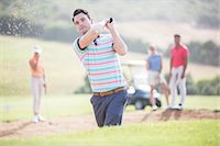 Friends playing golf on course Stock Photo - Premium Royalty-Freenull, Code: 6113-07159251