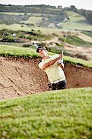 swing (sports) - Man swinging from sand trap on golf course Stock Photo - Premium Royalty-Freenull, Code: 6113-07159324