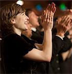 Happy woman clapping in theater audience Stock Photo - Premium Royalty-Freenull, Code: 6113-07159345