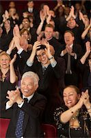 Enthusiastic theater audience clapping and cheering Stock Photo - Premium Royalty-Freenull, Code: 6113-07159354