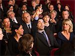 Man raising hand in theater audience Stock Photo - Premium Royalty-Freenull, Code: 6113-07159387