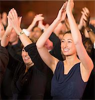 filipino - Enthusiastic women clapping in theater audience Stock Photo - Premium Royalty-Freenull, Code: 6113-07159408