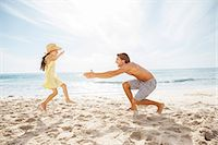 families playing on the beach - Father and daughter playing on beach Stock Photo - Premium Royalty-Freenull, Code: 6113-07159492