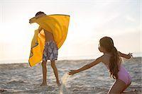 Children playing on beach Stock Photo - Premium Royalty-Freenull, Code: 6113-07159509
