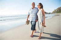 Senior couple walking on beach Stock Photo - Premium Royalty-Freenull, Code: 6113-07159523