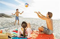 preteen girl topless - Family playing together on beach Stock Photo - Premium Royalty-Freenull, Code: 6113-07159539