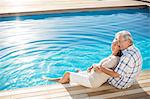 Senior couple relaxing by pool Stock Photo - Premium Royalty-Free, Artist: Aflo Relax, Code: 6113-07159551