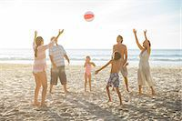 preteen girl topless - Family playing together on beach Stock Photo - Premium Royalty-Freenull, Code: 6113-07159554
