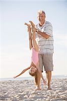 Older man playing with granddaughter on beach Stock Photo - Premium Royalty-Freenull, Code: 6113-07159557