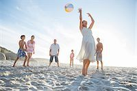 preteen girl topless - Family playing together on beach Stock Photo - Premium Royalty-Freenull, Code: 6113-07159559