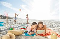 families playing on the beach - Family relaxing together on beach Stock Photo - Premium Royalty-Freenull, Code: 6113-07159577