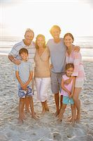 preteens pictures older men - Family smiling together on beach Stock Photo - Premium Royalty-Freenull, Code: 6113-07159595