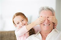 Girl covering grandfathers eyes Stock Photo - Premium Royalty-Freenull, Code: 6113-07159671